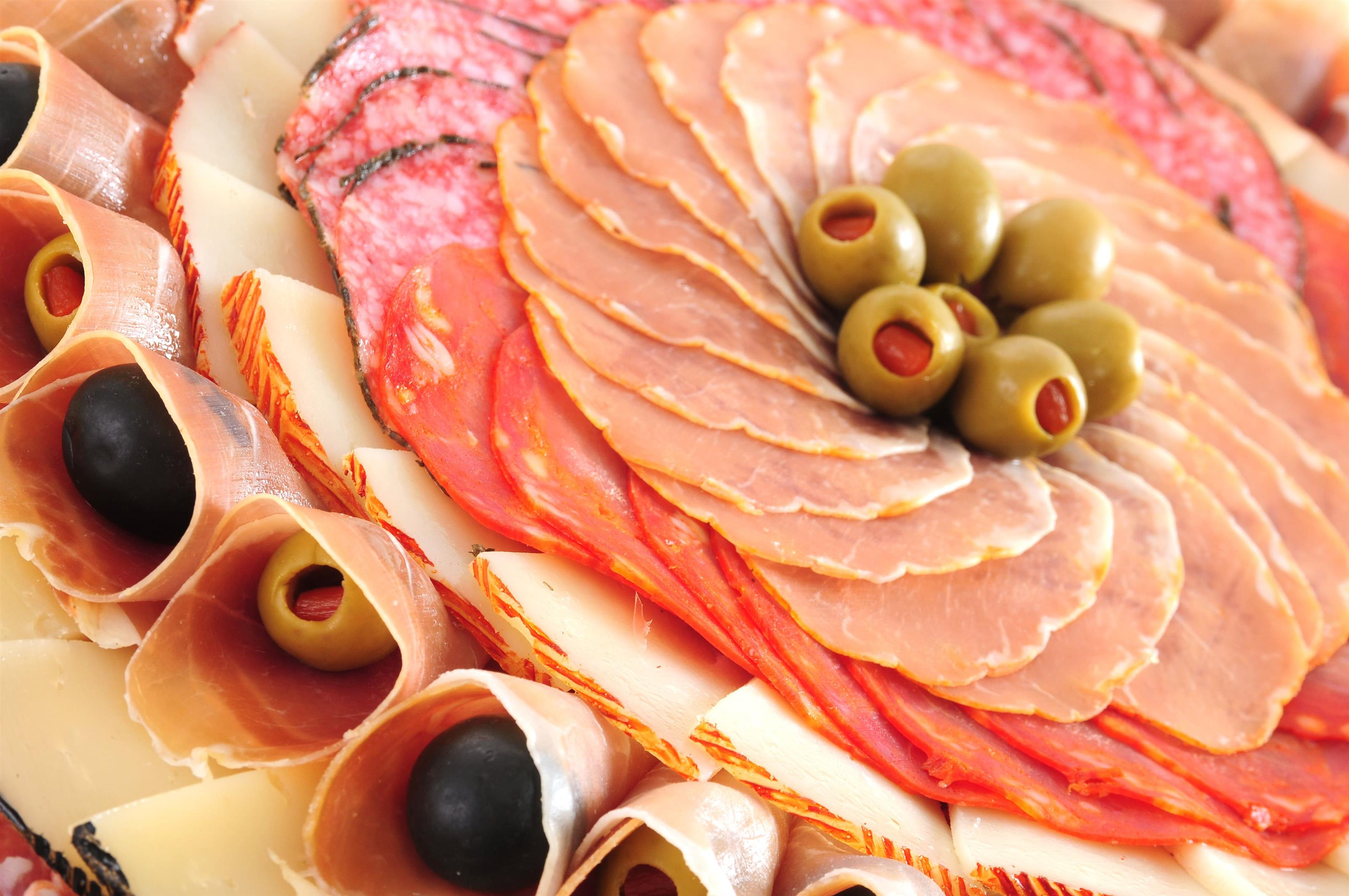 Spread of italian meats with olives.