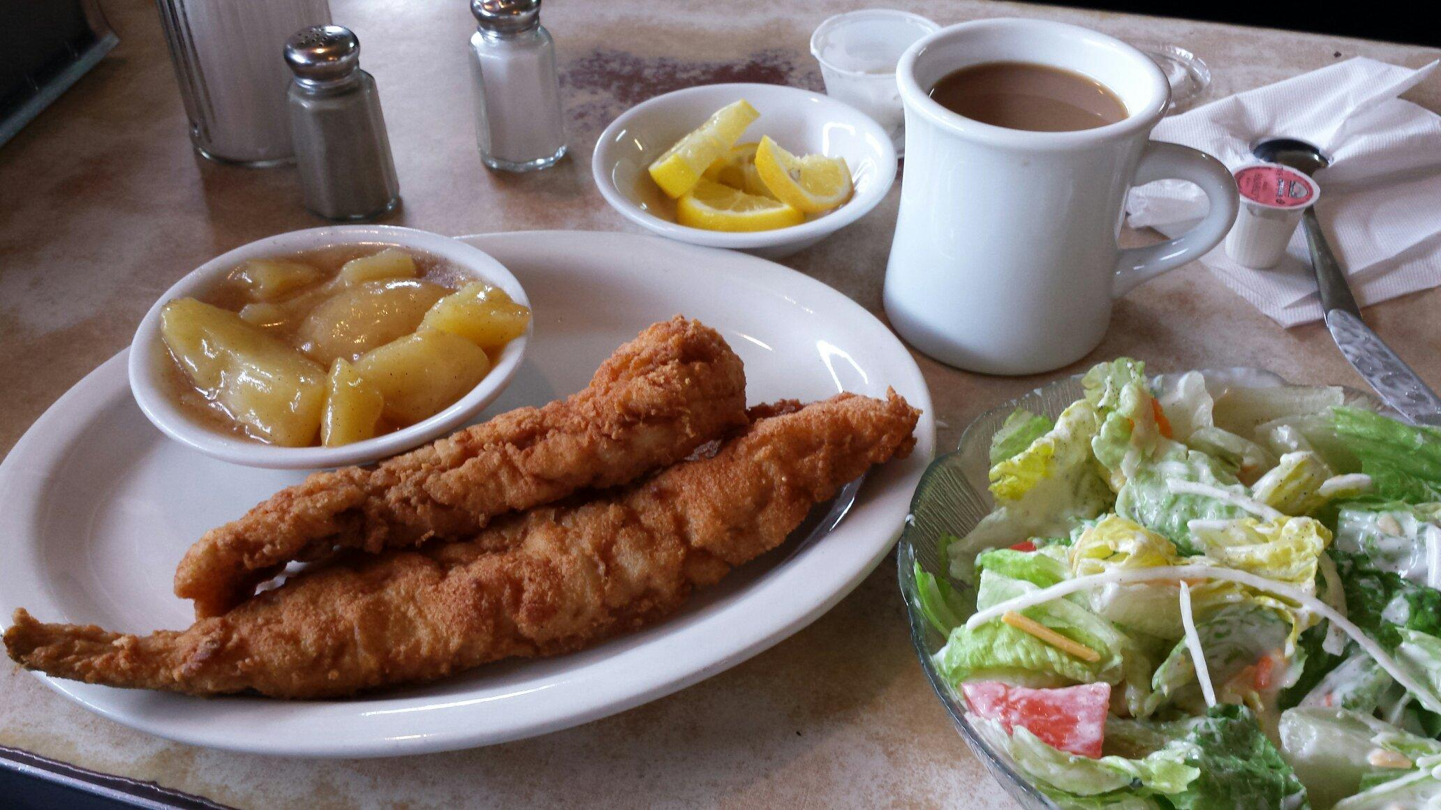 Chicken strips with side of apples and side salad.