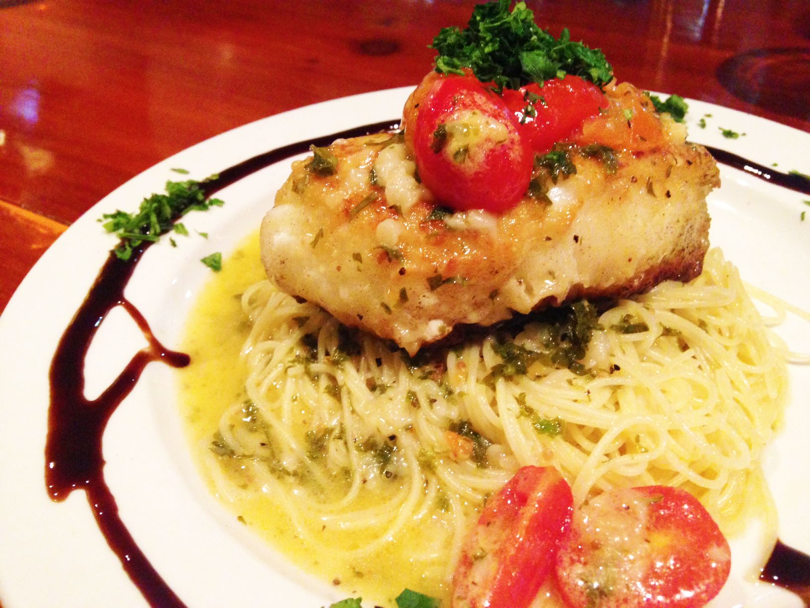 Fresh chilean sea bass over angel hair pasta in lemon butter sauce.