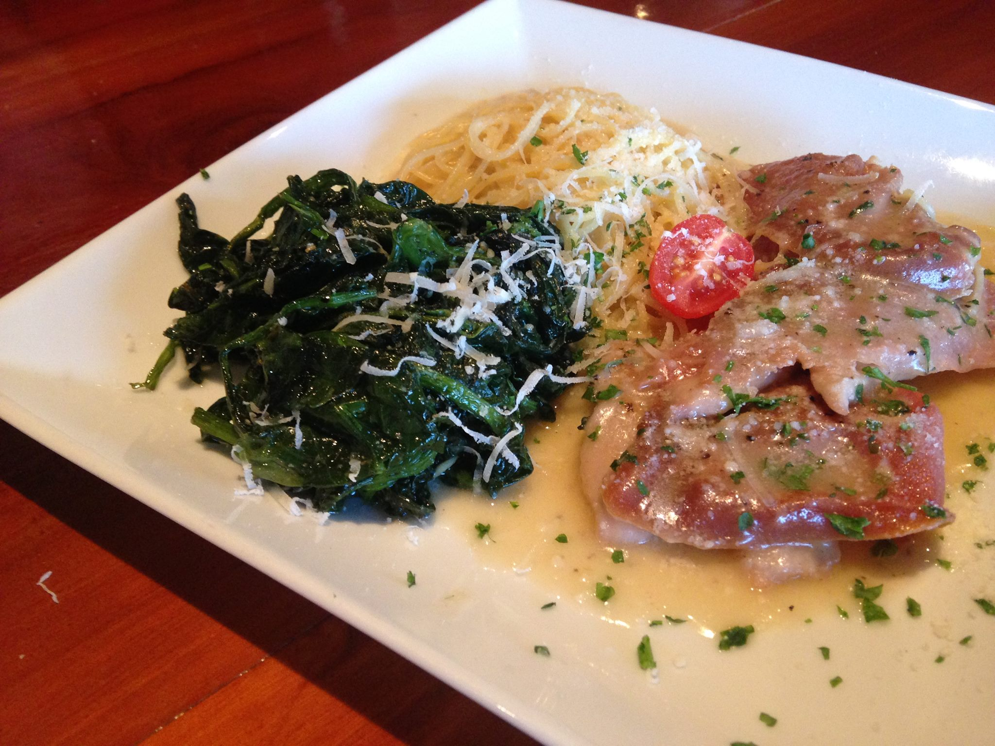 Saltimbocca alla romano. Prosciutto, Sage & White Wine Sauce with angel hair pasta, side of sauteed spinach.