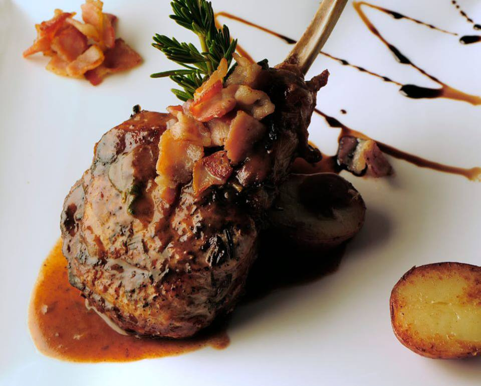 Grilled Lamb chop with sauce on dish