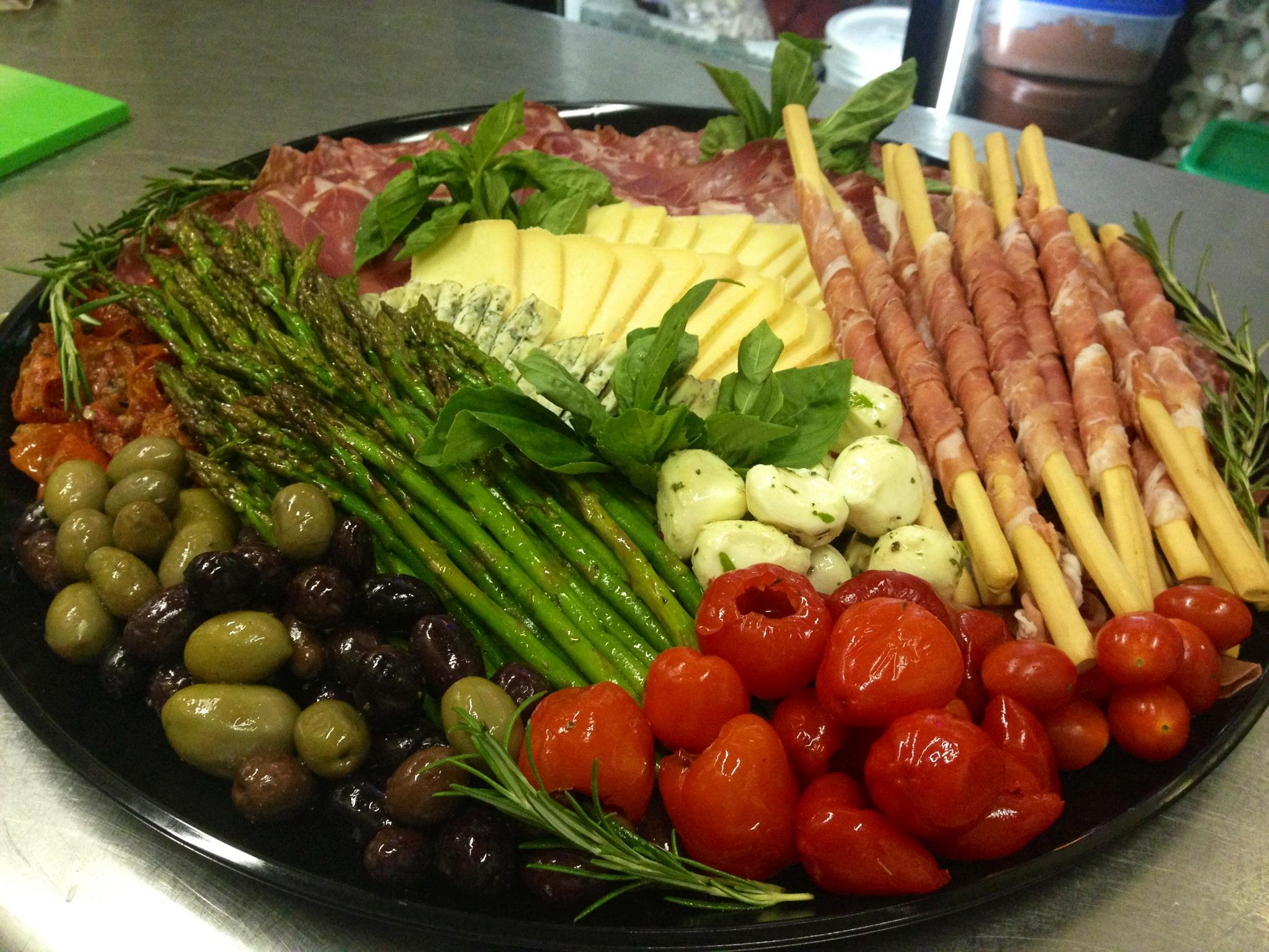 Tray of peppers, olives, cheeses, asparagus and italian cured meats