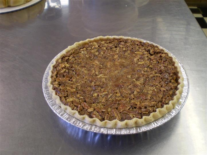 large pecan pie on a counter