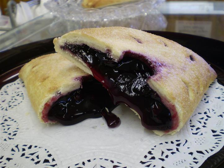 blueberry pastry on a plate cut in half