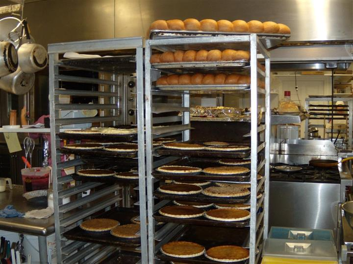 various pies and pastries on a large metal cooling rack