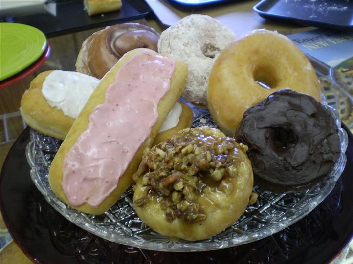 plate full of donuts and pastries