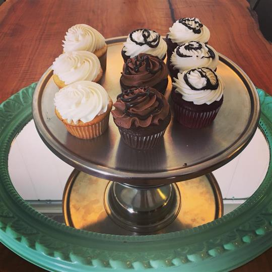 platter of mixed cupcakes flavors such as chocolate an