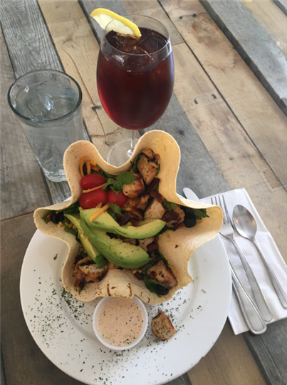 Image of Southwest Grilled Chicken Salad with Mixed greeens served in a tortilla shell