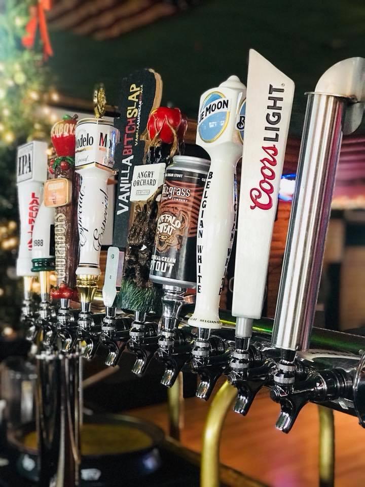 Line of beer taps including coors light, blue mooon, modelo, angry orchard and more