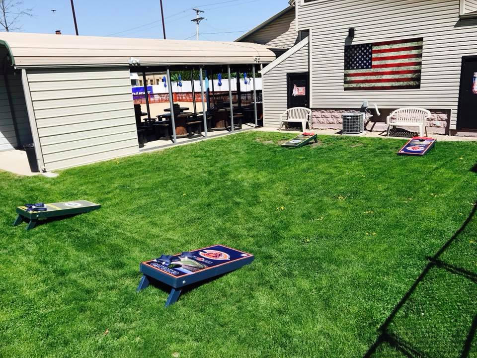 Outside area with bean bag toss on grass