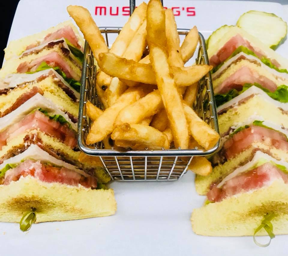 BLT cut into fours with a side of fries