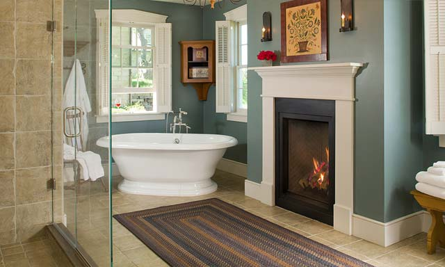 inside the suite with a bathtub and fireplace