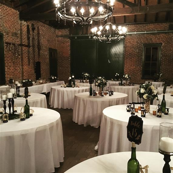 decorated tables in a wedding venue