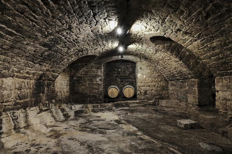 The Hermannhof Wine Cellar is ade of stone and is arched all the way from front to back.  A couple doorways are cut out of the stonework.  At the far end, two wine barrels rest of theis side in what used to be an elevator powered by draft horses.