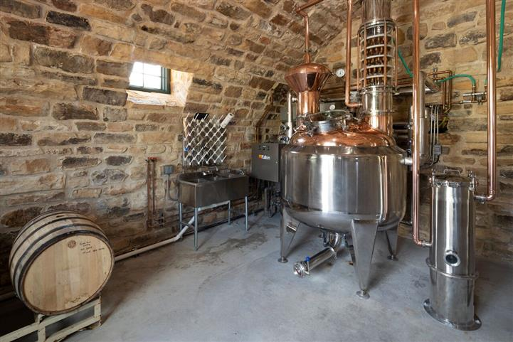 brick room with distillery and wine barrel