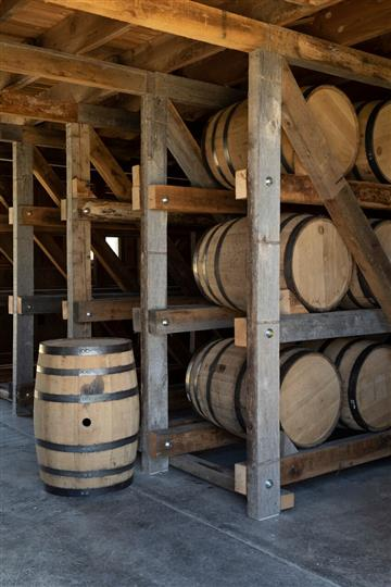 three rows of wine barrels