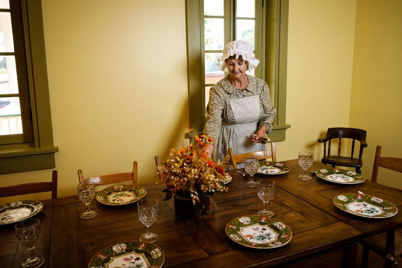 lady standing next to a decorated table