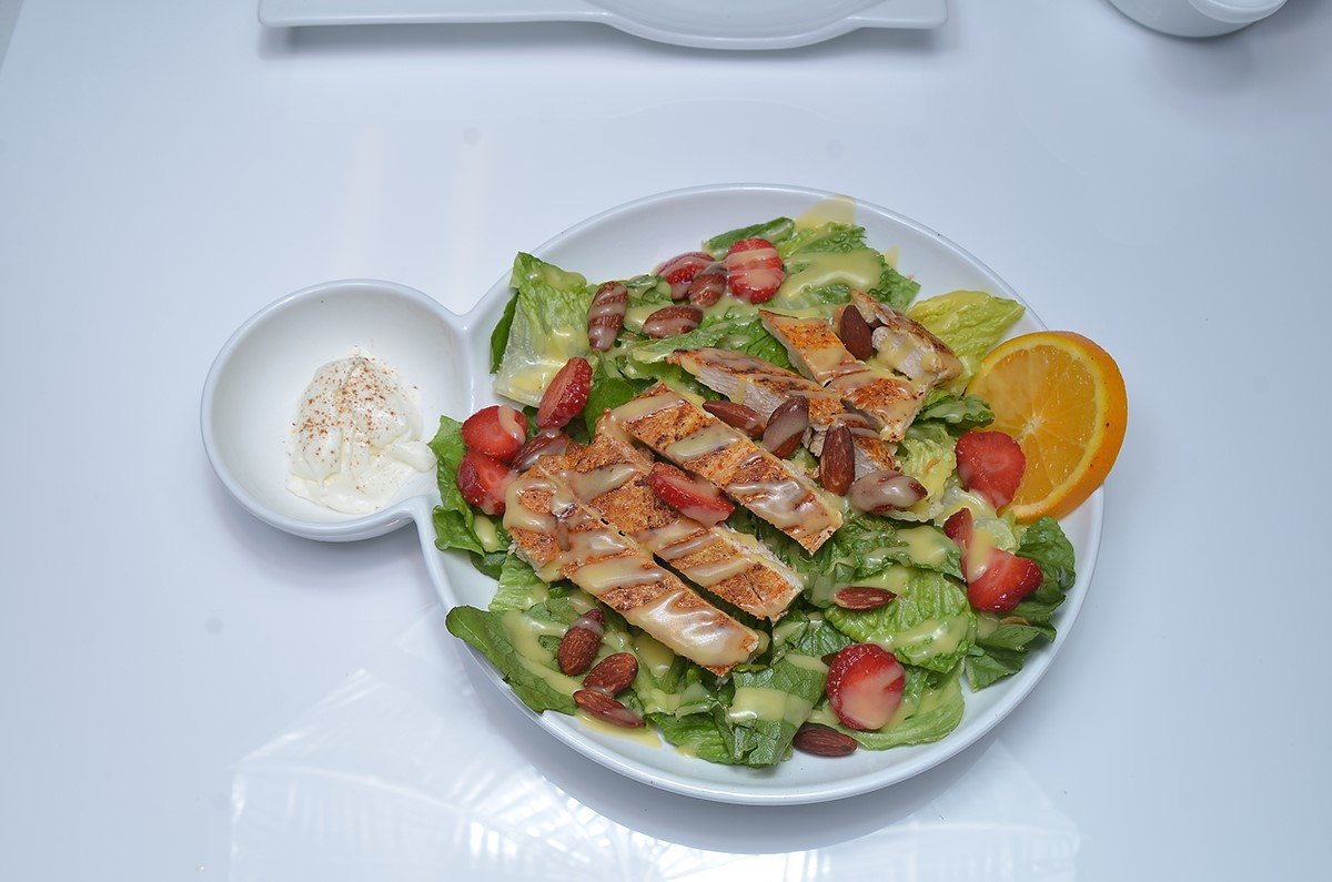Strawberry delight salad. Strawberry mixed green salad, grilled chicken with candied pecans, cheese and Balsamic Vinaigrette