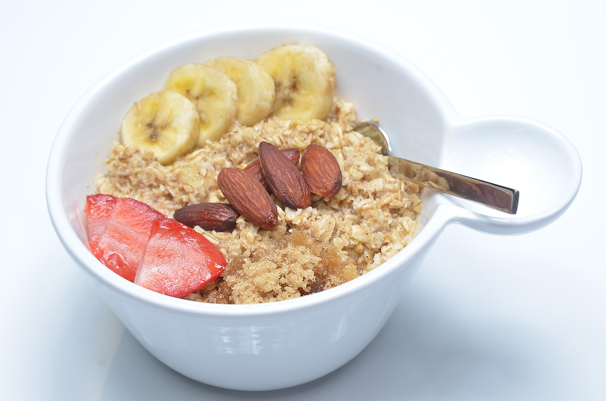 Steel cut oatmeal with almonds, bananas, strawberries.