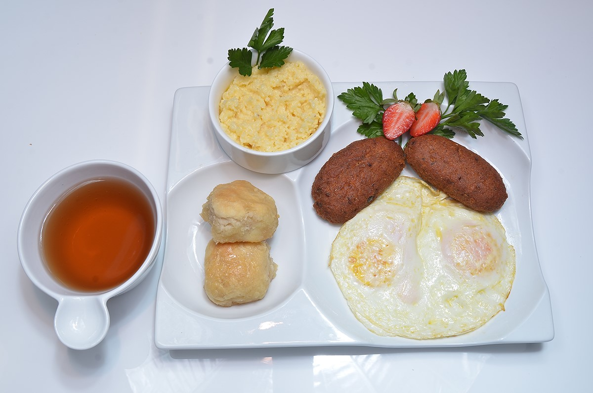 Two eggs, biscuits, strawberries, salmon croquettes, side of grits.