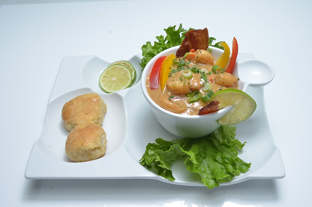 Shrimp and grits served with two biscuits