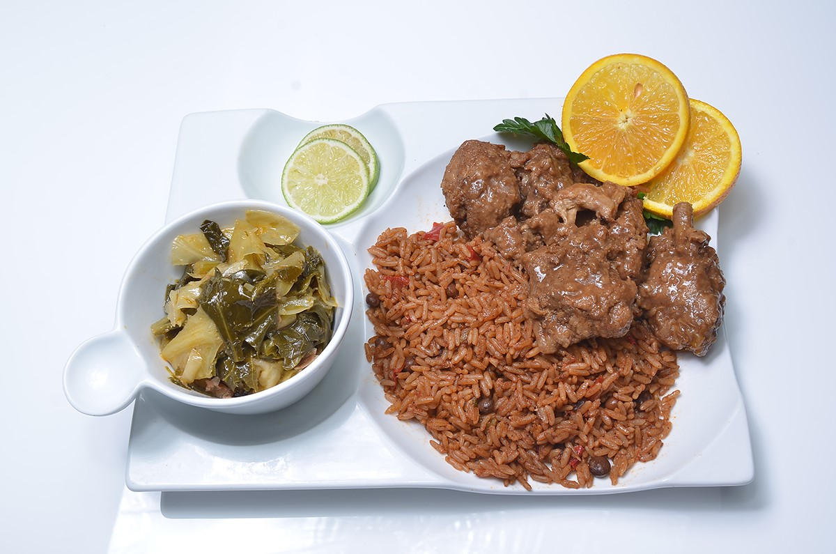 Ox tails and rice with side of collard greens