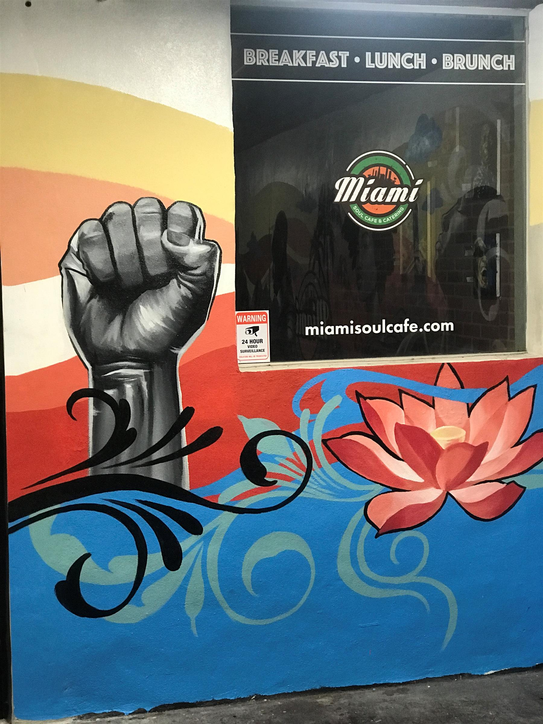 Miami Soul Cafe fist artwork on wall