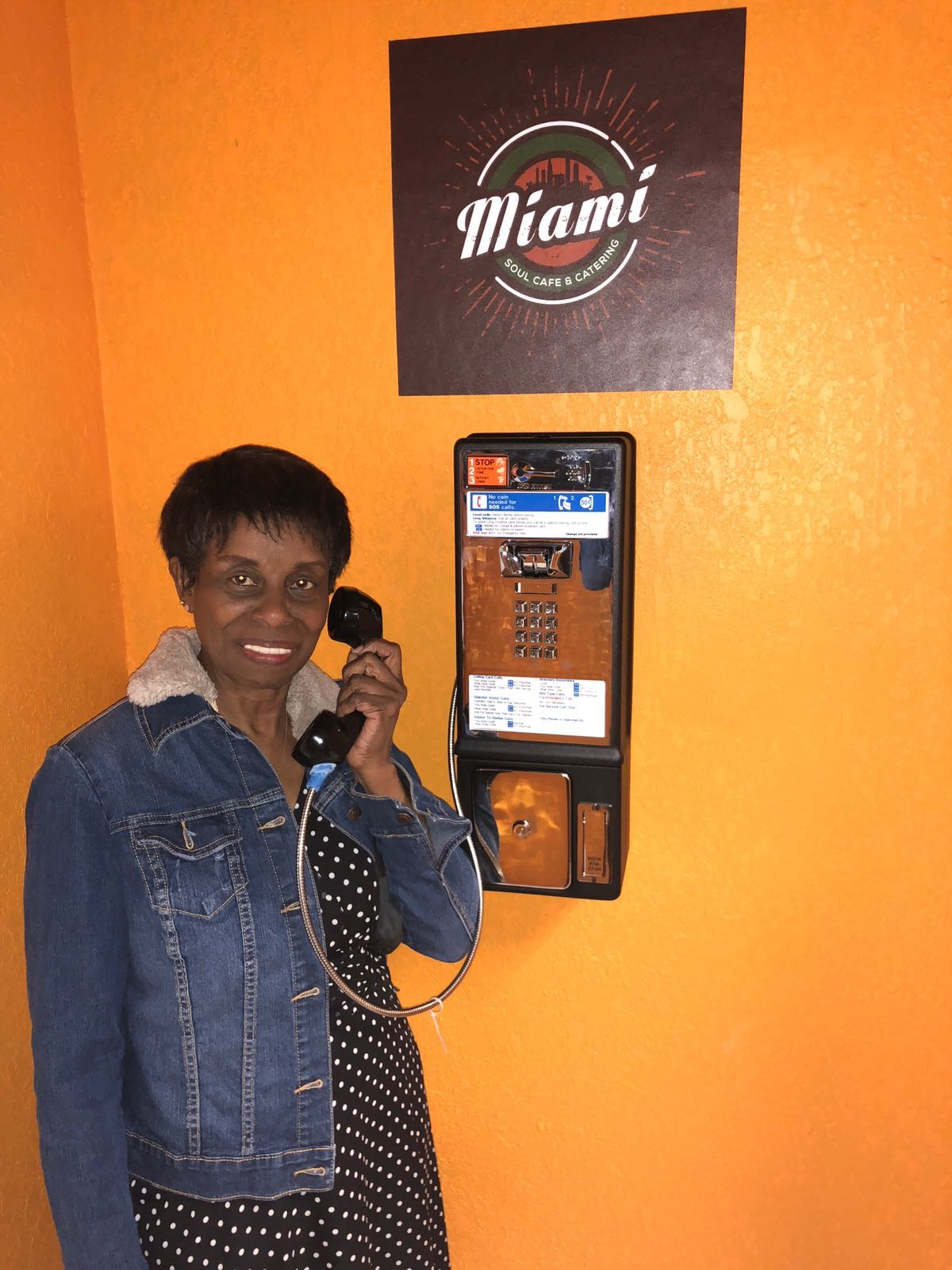 Woman on payphone inside cafe