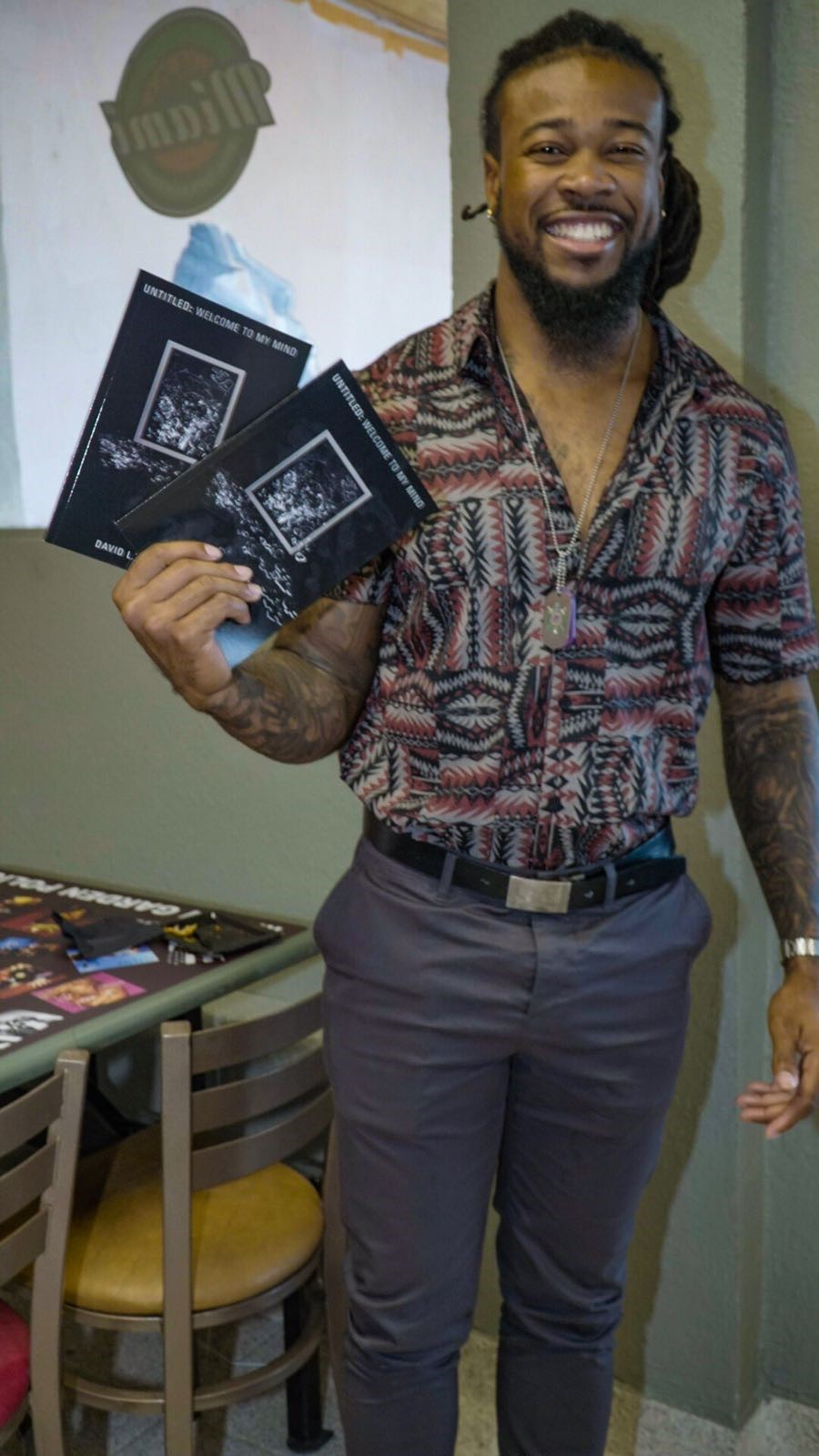 David L. Jackson holding copies of book - Untitled, welcome to my mind