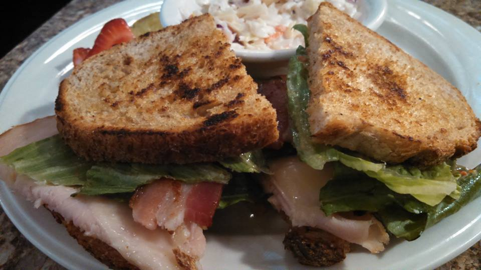 Heirloom turkey sandwich. Heirloom tomatoes, turkey, mayonnaise, Havarti, romaine & onions.