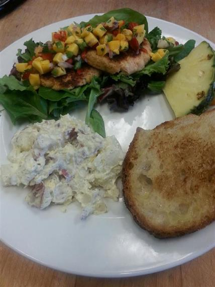 Jerk pork loin with mango salsa, bread, smashed redskin potatoes