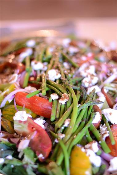 Asparagus, tomatoes, red onions and crumbled cheese