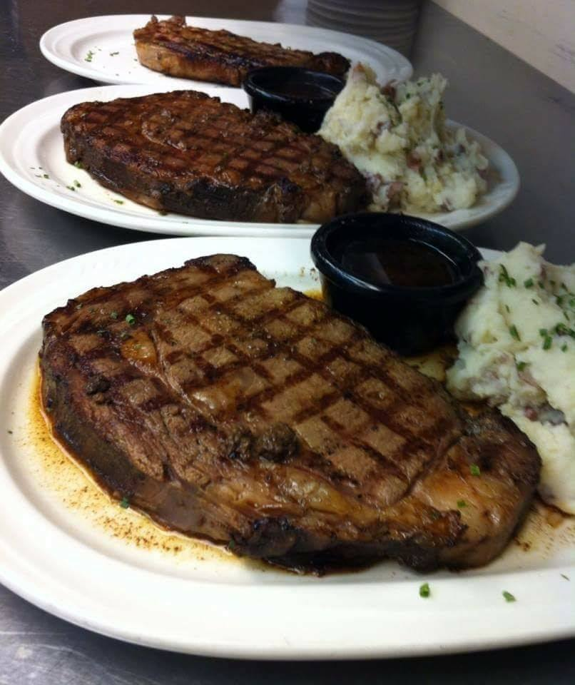 Grilled ribeye steaks with mashed potatoes