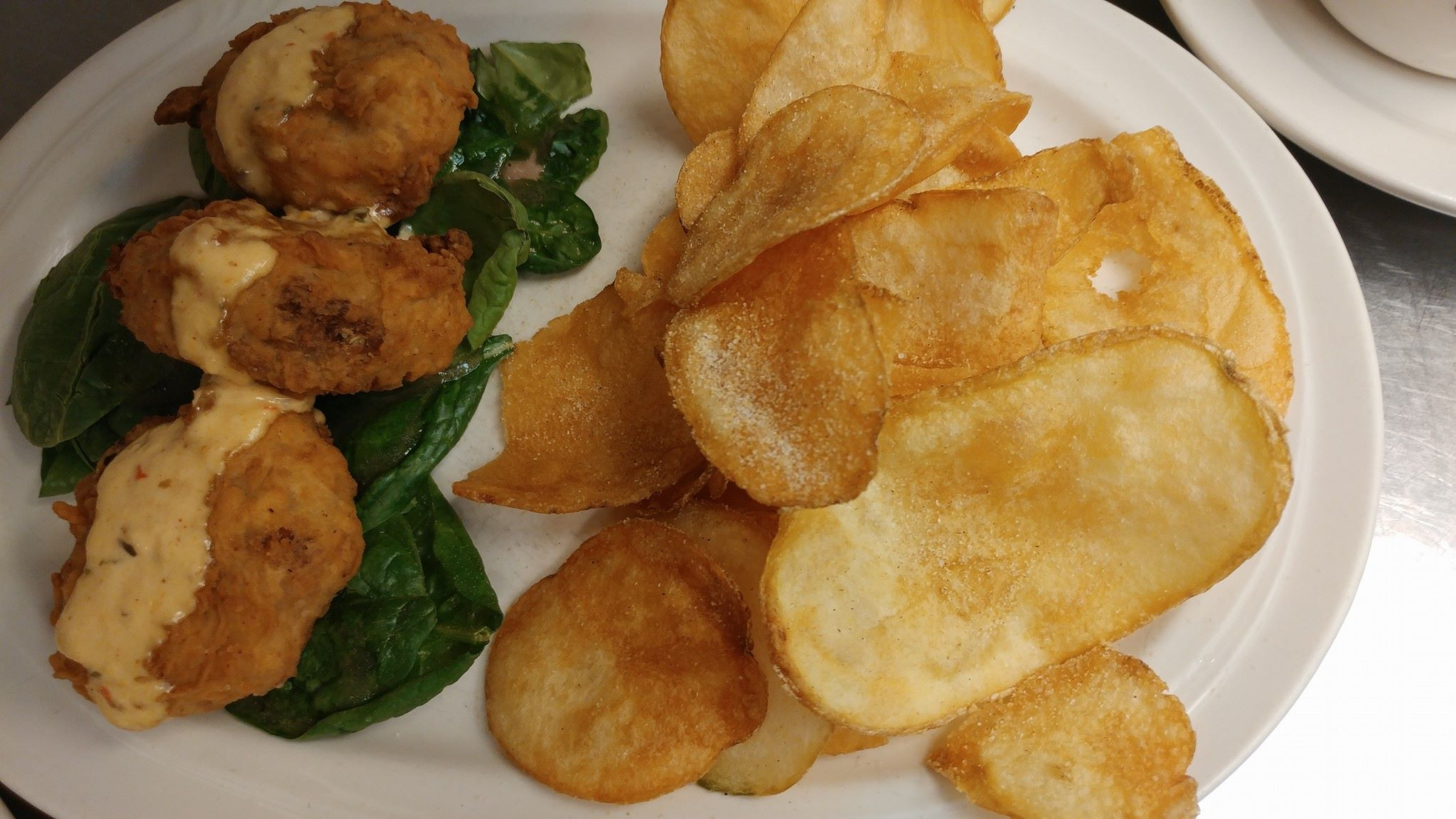 Fried portobello mushrooms. Lightly breaded and served with creamy ranch dressing, side of potato chips.