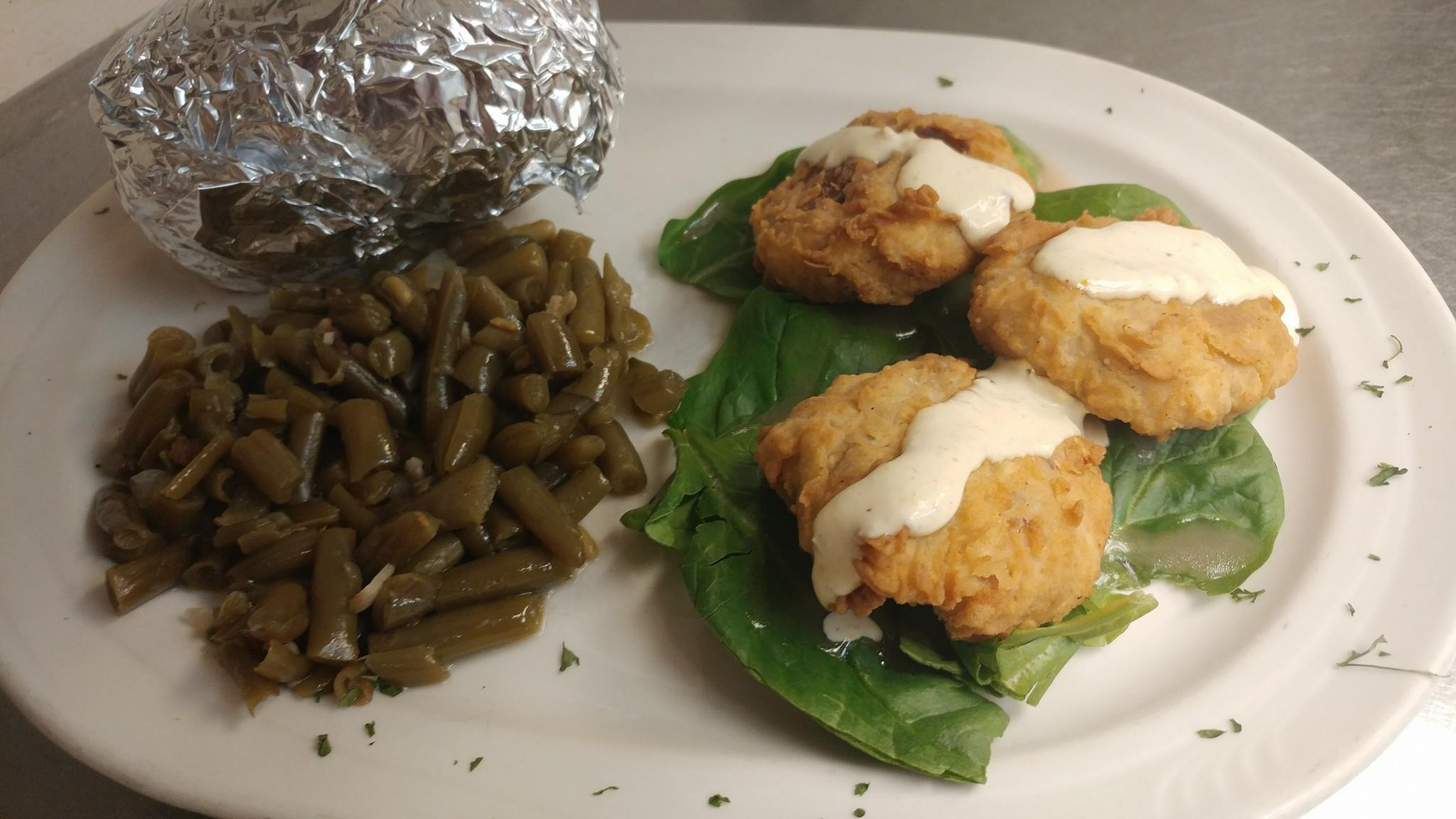Fried portobello mushrooms. Lightly breaded and served with creamy ranch dressing, side of green beans.