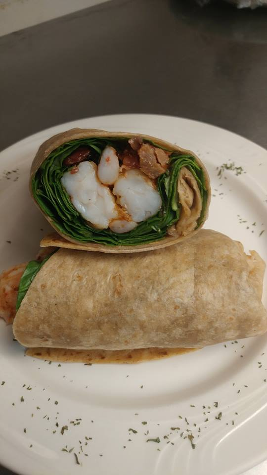 Bourbon shrimp wrap. Your choice of 5 grilled, blackened or hand-breaded shrimp tossed in bourbon glaze wrapped with bacon and fresh spinach leaves.