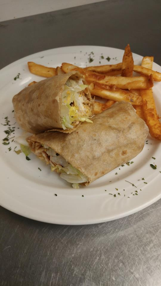 Chicken wrap with lettuce, side of fries.