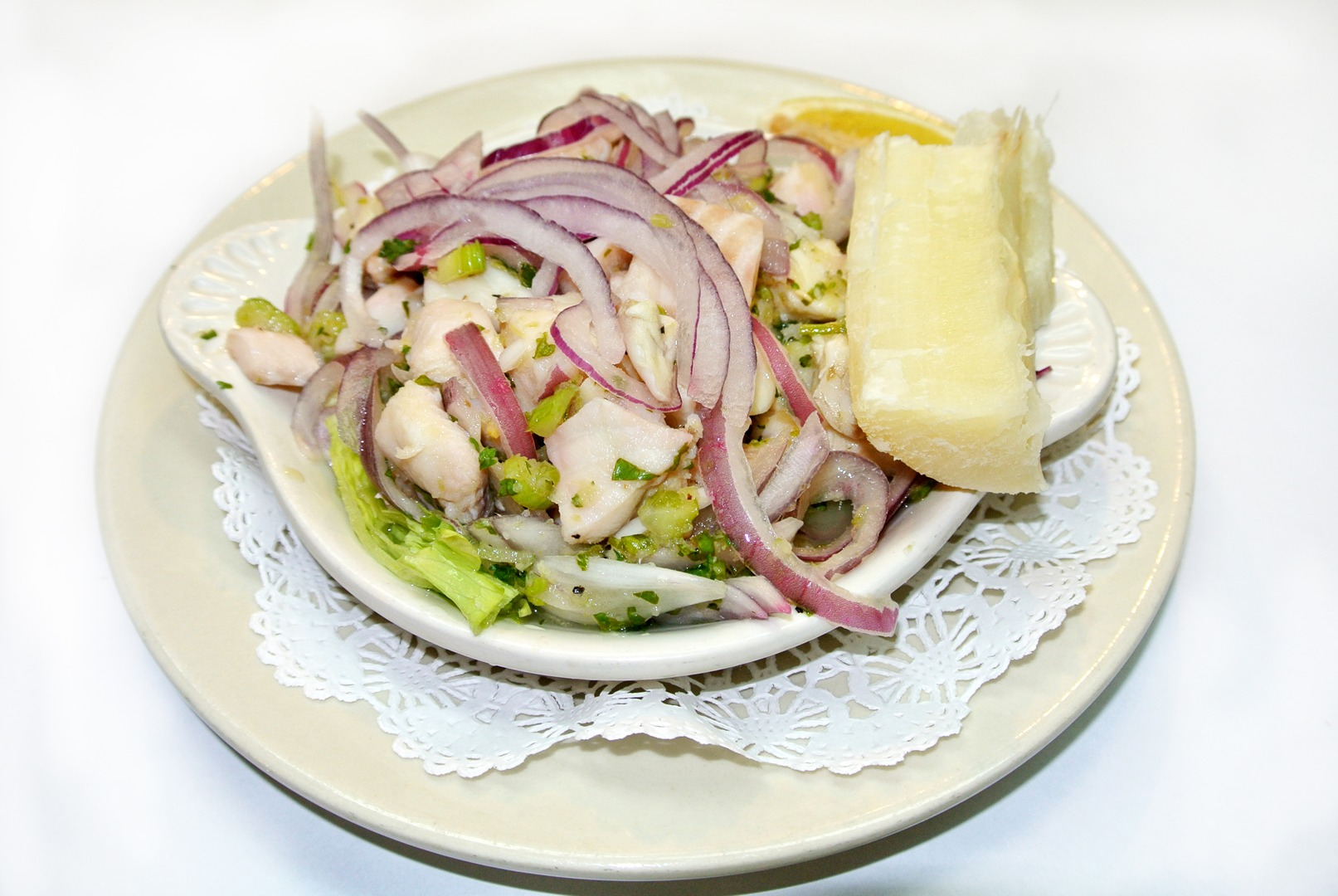 Seafood salad topped with strings of red onions