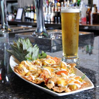 California fusion nachos. Six Wontons Topped With Chicken, Pineapple, Green Onion, Tomato, Garlic, Peanut Satay And Three Cheese Blend, Topped With Cusabi Drizzle