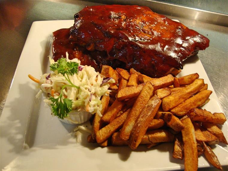 Kansas city back ribs. Smoked Pork Back Ribs Smothered In A Smokey Bbq Sauce, Served With Fresh Cut Fries And Maple Bacon Coleslaw