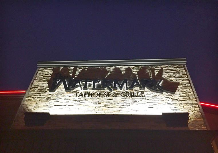 The Watermark Taphouse & Grille sign on exterior wall.