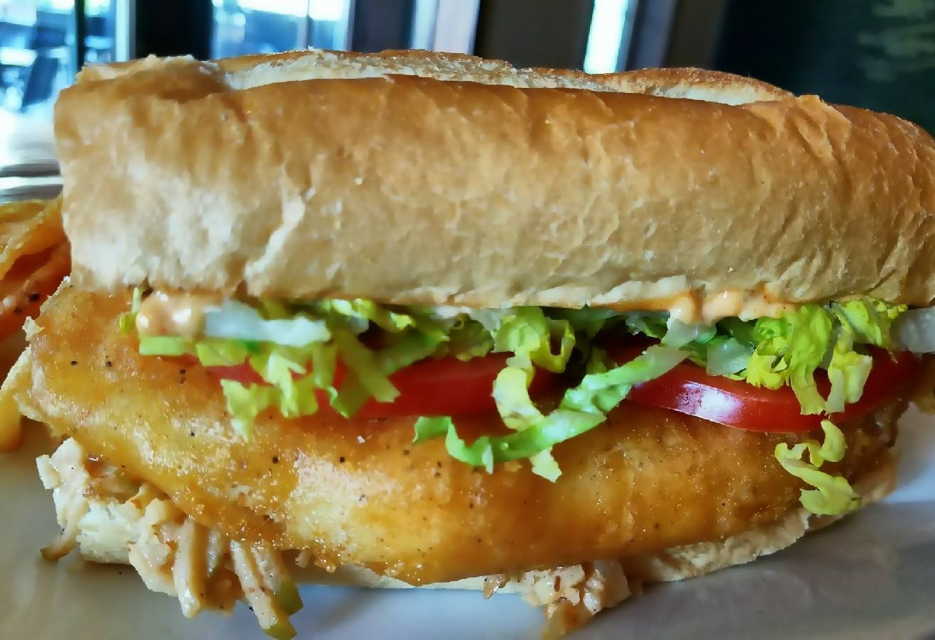 fried fish sandwich in a large sub