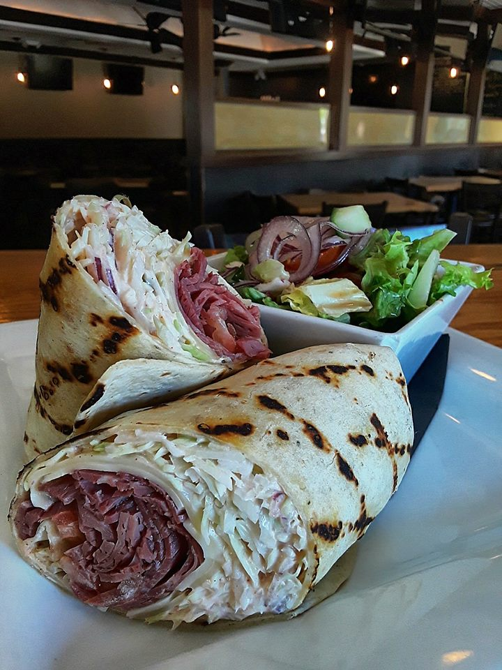 pulled pork wrap with coleslaw and a side salad
