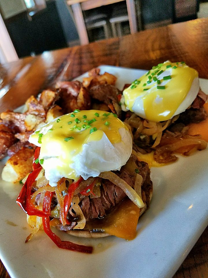 pulled pork sandwiches with eggs benedict on top
