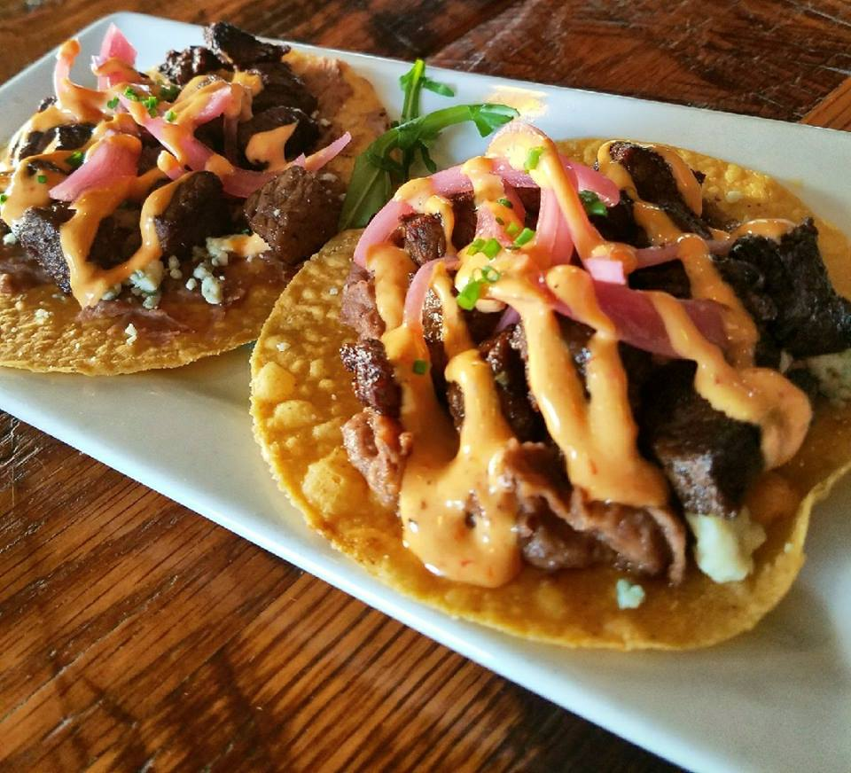 two large tacos with steak, vegetables and sauce
