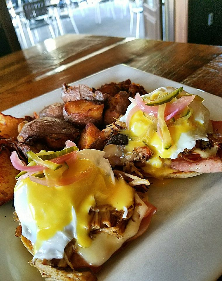 eggs benedict with ham and a side of home fries