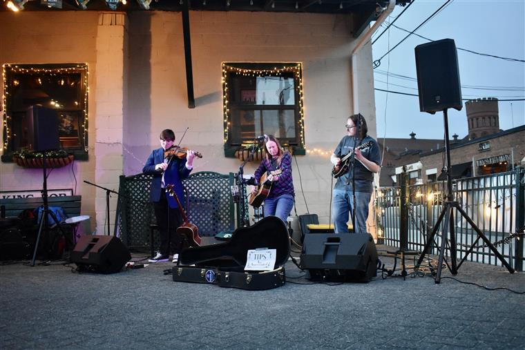 Maggie's Trio performing on the patio