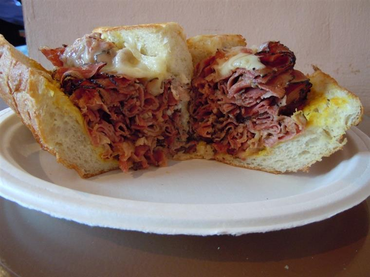 Pastrami sandwich on white plate