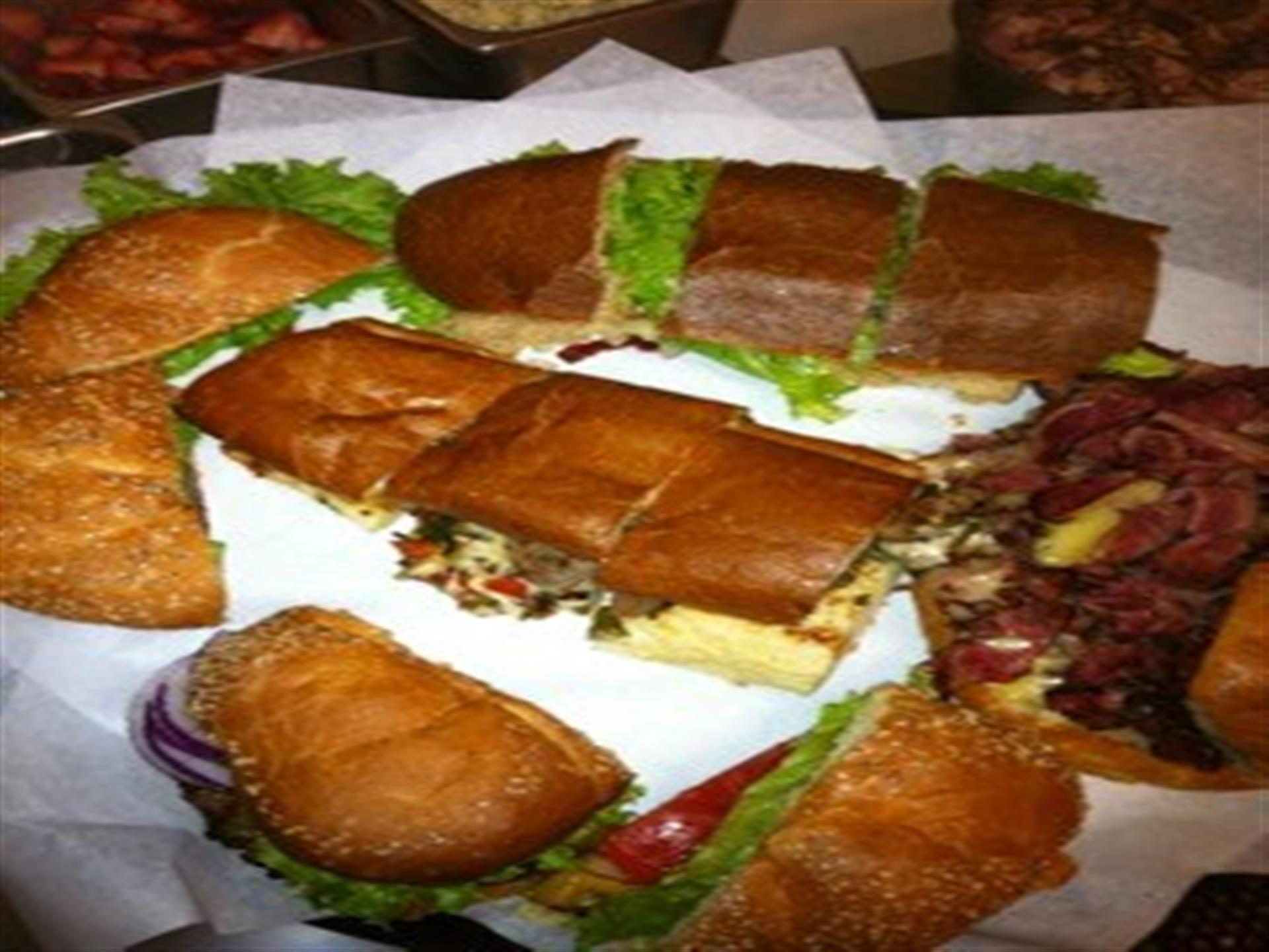 Assortment of sandwiches on parchment paper