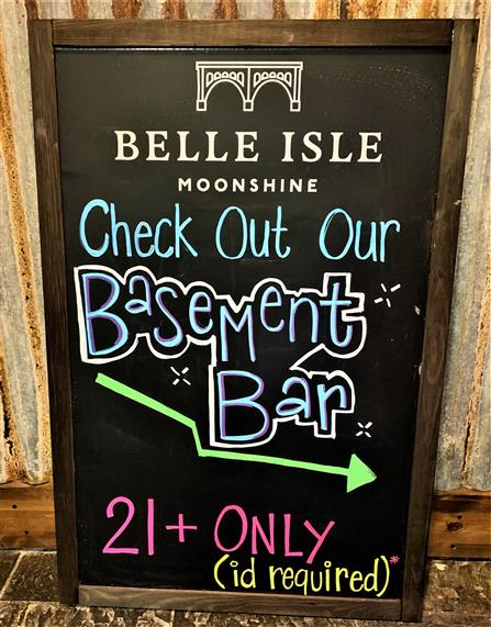 "sign that reads, ""Check out our Basement Bar - 21+ Only (ID Required)"""